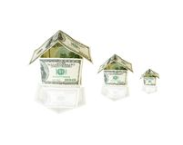 Houses made from dollar bills. Green houses made from dollar bills Stock Photo