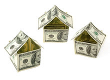 Houses made of hundred dollar notes. Isolated on white Stock Images