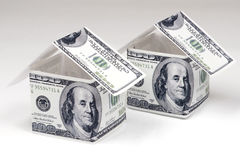 Houses made of hundred dollar notes Stock Images