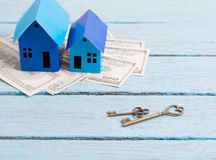Houses made of paper, keys and money Stock Photo