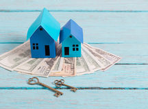 Houses made of paper, keys and money Royalty Free Stock Photo