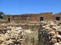 Houses made of stone in Lampedusa. Ancient peasant houses made of stone in Lampedusa Island in Sicily Italy royalty free stock image
