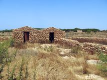 houses made of stone in Lampedusa Stock Photo