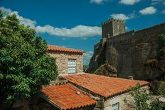 Houses made of stone with orange tree and castle royalty free stock images