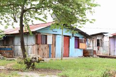 Houses in Manokwari. Houses made from wooden planks with roof from corrugated iron in Manokwari, Papua Barat, Indonesia stock photography