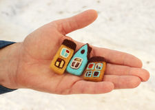Houses in man's hand Royalty Free Stock Image