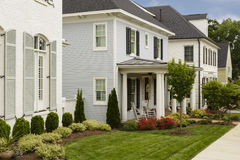Houses with manicured lawns Royalty Free Stock Photo