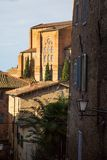 The houses of medieval town in Tuscany, Italy and cypress trees Royalty Free Stock Photo