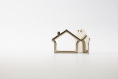 Houses. Metallic small houses isolated on a white background Royalty Free Stock Images