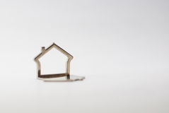Houses. Metallic small houses isolated on a white background Royalty Free Stock Image