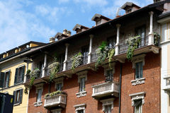 Houses of Milan with balconies, decorated with green plants Royalty Free Stock Images