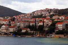 Houses near Dubrovnik Croatia. Modern buildings on the fiord leading to Dubrovnik Croatia Stock Photos