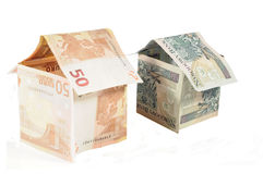 Houses with the money of the euro and pln. The photo shows the euro banknotes and Polish arranged in the shape of houses Stock Photography