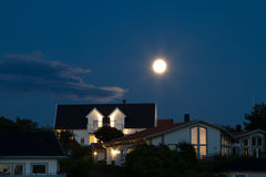Houses with moon. Lighted houses which are illuminated by the full moon Stock Photos