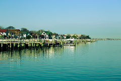 Houses and moorings for boats on the seashore. Toned Royalty Free Stock Photography