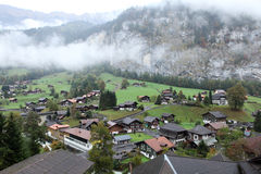 Houses and mountain stock images