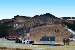 Houses in a mountain landscape, Iceland Royalty Free Stock Photos
