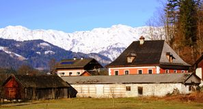 Houses and Mountain with Snow at Salzkammergut Stock Photo
