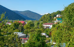 Houses in mountain valley Stock Images