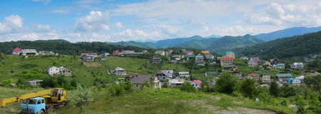 Houses in a mountainous area, panorama Stock Images