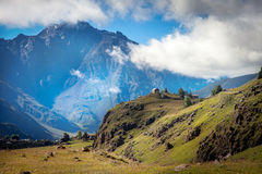 Houses in the mountains on a beautiful background of mountains a Royalty Free Stock Photography
