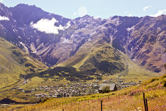 Houses in the mountains on a beautiful background of mountains a Royalty Free Stock Image