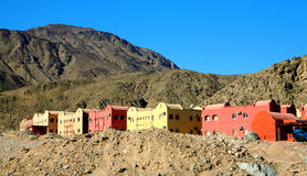 Houses in the Mountains Egypt, Africa. These colorful Houses are found in the mountains in Egypt, Africa, against a blue sky is surrounded by the mountains Royalty Free Stock Photography