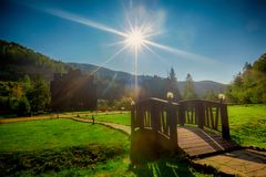 Houses in the mountains. Sun and sky Royalty Free Stock Photo