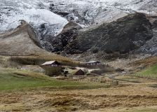 Houses in the mountains of Iceland.  Stock Photos