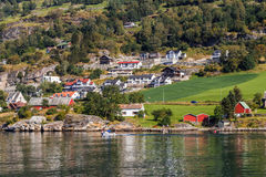 Houses in mountains. Landscape with houses in mountains at Norway fjord Stock Photo