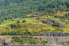 Houses in mountains. Landscape with houses in mountains at Norway fjord Stock Images
