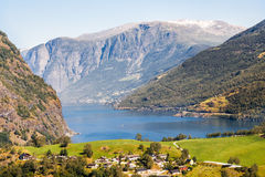 Houses in mountains. Landscape with houses in mountains at Norway fjord Royalty Free Stock Photography