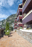 Houses with mountains. Houses with trees of Andorra la Bella, located in the Pyrenees mountains,  on a sunny day. It´s a vertical picture Stock Photography