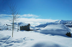 Houses and mountains under sno Royalty Free Stock Image