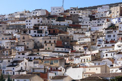 Houses on the mountainside white Stock Images
