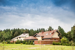 Houses near forest Royalty Free Stock Photos