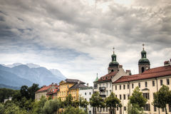 Houses near the Inn river in Innsbruck, Austria. Typical Austrian houses at the embankment of the Inn river in Innsbruck, Austria with the Alps in the background Royalty Free Stock Photo