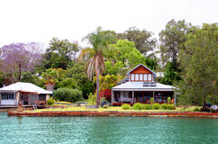 Houses near a lake and tropical forest Royalty Free Stock Photography