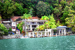 Houses near a lake and tropical forest Stock Image