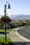Houses - Neighborhood. Lamppost with hanging flower basket in subdivision Royalty Free Stock Photography