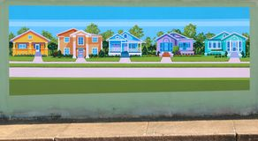 Houses In A Neighborhood Mural On James Road in Memphis, Tennessee. Beautiful local artist rendering of houses on a bridge underpass in the Raleigh-Frayser area Royalty Free Stock Photo