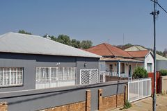Houses in a neighborhood in Southern Johannesburg. Houses in a neighborhood in a less wealthy area of Southern Johannesburg, South Africa Royalty Free Stock Images