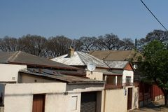 Houses in a neighborhood in Southern Johannesburg. Houses in a neighborhood in a less wealthy area of Southern Johannesburg, South Africa Royalty Free Stock Photography