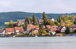 Houses next to lake. And in Stein Reim in Switzerland. some boats are. It is an editorial image on a sunny day stock images