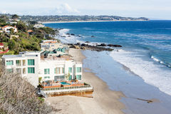 Houses by ocean in Malibu california. Modern houses overlook ocean and waves by El Matador state beach in Malibu California Royalty Free Stock Photos
