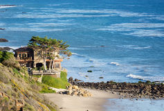 Houses by ocean in Malibu california. Modern houses overlook ocean and waves by La Piedra state beach in Malibu California Royalty Free Stock Images