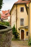 Houses in old narrow street with cobble stones in Meissen, Germany royalty free stock photos