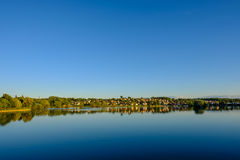 Houses on the other side of the water. On a clear day royalty free stock images
