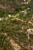 Houses on the outskirts of Queenstown Tasmania. Queenstown, Tasmania, Australia, Ocotber 10, 2013: Aerial view of houses on the outskirts of the small west coast royalty free stock photos