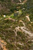 Houses on the outskirts of Queenstown Tasmania. Queenstown, Tasmania, Australia, Ocotber 10, 2013: Aerial view of houses on the outskirts of the small west coast stock photo
